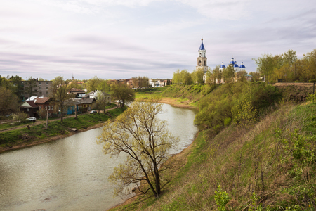 Scenic cityscape Kashin town in spring, Resurrection Cathedral on the high bank of the Kashinka River, Tver region, Russia Фото со стока
