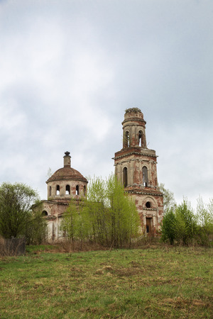 Ruins of an old abandoned russian church with bell tower. The Church of the Nativity of Christ in the village of Rozhdestvo in Tver region, Russia Фото со стока