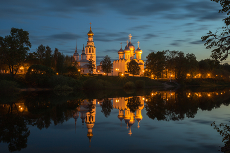 Vologda, night view of the illuminated Kremlin with a mirror image in the water of river