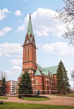 Lutheran Church in Kotka (Kotkan kirkko), main church in city, is built of red brick in Neo-Gothic style. Kotka, Finland Stock Photo