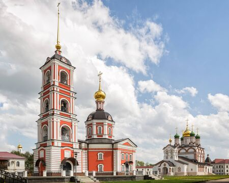 Previously destroyed churches of ancient Trinity-Varnitsky Monastery were rebuilt. Trinity Cathedral with bell tower (red) and St. Sergius of Radonezh Cathedral (white). Village of Varnitsa, Rostov th 写真素材