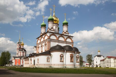Restored temples of ancient Trinity-Varnitsky monastery. Trinity Cathedral with bell tower (red) and St. Sergius of Radonezh Cathedral (white). The village of Varnitsa, Rostov the Great, Russia 写真素材