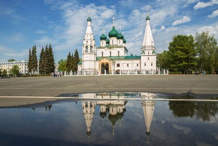 Church of Elijah the Prophet is reflected in the water of a rain puddle, Yaroslavl. Golden ring of Russia 写真素材
