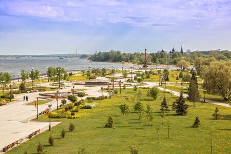 View of Strelka Park at confluence of Volga and Kotorosl rivers, monument to the 1000th anniversary of Yaroslavl and temple complex in Korovniki, Yaroslavl, Russia