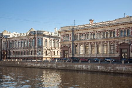 Historic buildings of the loan treasury (left) and state savings banks (right) on the Fontanka River embankment were built in 1900. St. Petersnurg, Russia