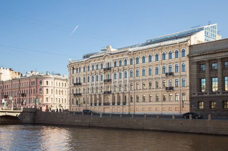 Modern building on the embankment of the Fontanka river was built on the site of a destroyed old apartment building with the preservation of the historical facade. Saint Petersburg, Russia 写真素材 - 134720525