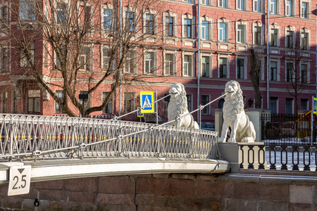 Sculptures of lions on the Lion Bridge over the Griboedov Canal, an ancient pedestrian suspension bridge built in 1826. Saint-Petersburg, Russia