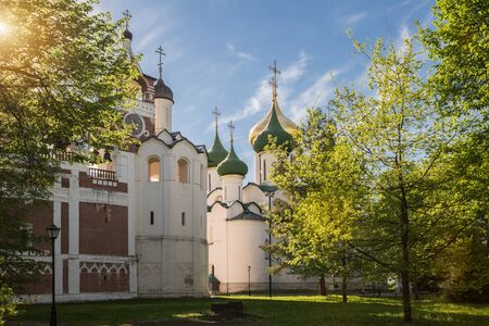Spaso - Evfimievsky monastery (Saviour Monastery of St. Euthymius). Sunlit Monastery Park, Transfiguration Cathedral and Belfry with Church of Nativity of John the Baptist. Suzdal, Golden Ring of Russ 写真素材