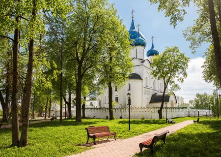 Park near walls of Nativity Cathedral in Kremlin of ancient city Suzdal, Golden Ring of Russia.