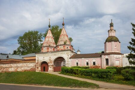 Two-domed Holy gates of Rizopolozhensky monastery in Suzdal. Rizopolozhensky Monastery is one of the oldest monasteries in city of Suzdal, Golden Ring of Russia