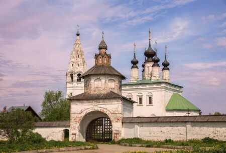 Alexander Monastery in Suzdal. Church of Ascension of the Lord and bell tower behind Holy Gates in old Russian monastery of St. Alexander. Suzdal, Golden Ring of Russia