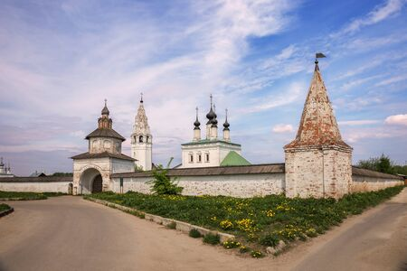 Alexander Monastery in Suzdal. Ascension Church, bell tower, Holy Gates and wall with towers in the old Russian monastery of St. Alexander. Suzdal, Golden Ring of Russia 写真素材