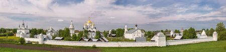 Panoramic view of the Pokrovsky monastery in spring day. Holy Intercession Convent in Suzdal. Panorama of old Russian monastery with fortified walls and towers. Suzdal, Golden Ring of Russia 写真素材 - 136791951