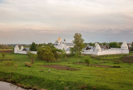 View of the Pokrovsky monastery in spring evening. Holy Intercession Convent in Suzdal. Old Russian monastery on banks of Kamenka River. Suzdal, Golden Ring of Russia
