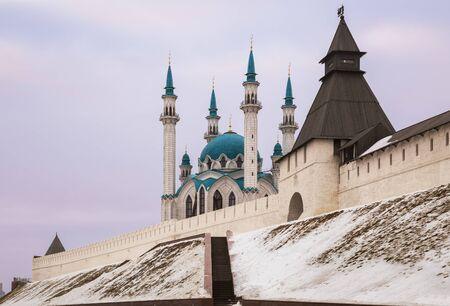 Wall and towers of the Kazan Kremlin and Kul Sharif Mosque on a cloudy winter day. Kazan, Tatarstan, Russia