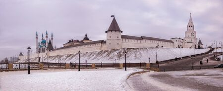 Panoramic view of Kazan Kremlin on winter cloudy day. Fortress walls, Spasskaya, Southwestern Round and other towers of Kazan Kremlin and Kul Sharif Mosque. Tatarstan, Russia 写真素材