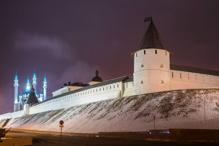 Wall and towers of Kazan Kremlin and Kul Sharif Mosque with lighting. Night view on a winter evening. Kazan, Tatarstan, Russia 写真素材 - 136792222