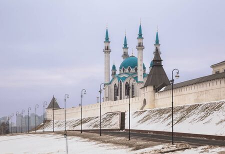 Kazan, cityscape. Wall and towers of the Kazan Kremlin and Kul Sharif Mosque on a cloudy winter day. Tatarstan, Russia