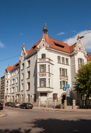 Riga Art Nouveau (Jugendstil), corner house with turrets, pediments and bay windows under tiled roof on the street Elizabetes (Elizabetes iela)