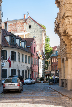 RIGA, LATVIA - SEPTEMBER 01, 2014: Narrow street in the historical center of the old town of Riga