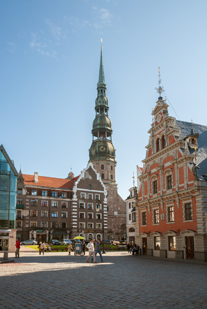 RIGA, LATVIA - SEPTEMBER 01, 2014: Town Hall Square, House of the Blackheads and St. Peter Church are the main attractions of the old city of Riga 写真素材 - 136769629