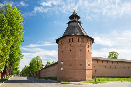 Suzdal, corner tower of fortress wall of St. Euthymius monastery. Lenin Street, main street of city, runs along the monastery wall. Golden ring of Russia, Vladimir region