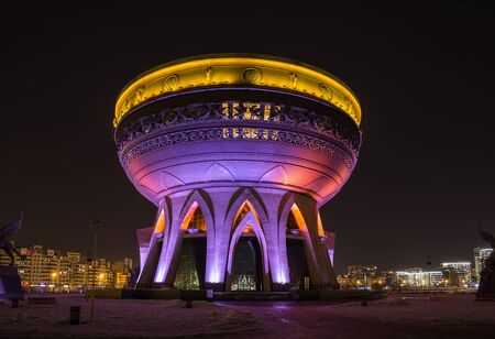 Family Center and Wedding Palace Kazan. Modern landmark of city on winter evening with colorful night illumination. Kazan, Tatarstan, Russia