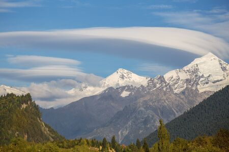 Lenticular clouds over the mountain peaks of the Caucasus