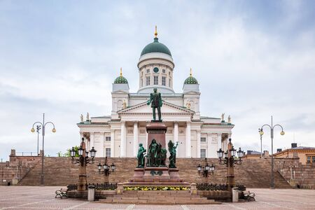 Monument to Emperor Alexander II and Helsinki Cathedral or St. Nicholas Church on Senate Square in Helsinki, Finland