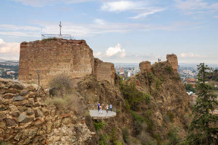 TBILISI, GEORGIA - SEPTEMBER 23, 2018: The ruins of the ancient Narikala fortress. Tourists on the viewing platform
