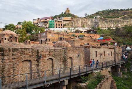 TBILISI, GEORGIA - SEPTEMBER 23, 2018: Abanotubani district of sulfur baths. Tourists sightseeing 報道画像