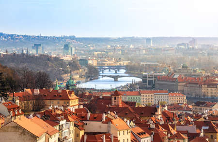 View from Strahov Monastery on red tiled roofs and bridges over the Vltava, Prague, Czech Republic