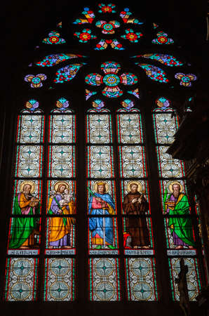 PRAGUE - MARCH 10, 2020: Interior of St. Vitus Cathedral in Prague. Stained glass window depicting Christian saints