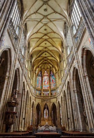PRAGUE - MARCH 10, 2020: Interior of St. Vitus Cathedral in Prague. Main nave and stained-glass windows above the altar