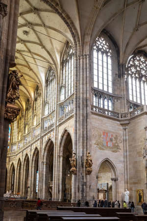 PRAGUE - MARCH 10, 2020: Interior of St. Vitus Cathedral in Prague. Tourists visiting the cathedral 報道画像