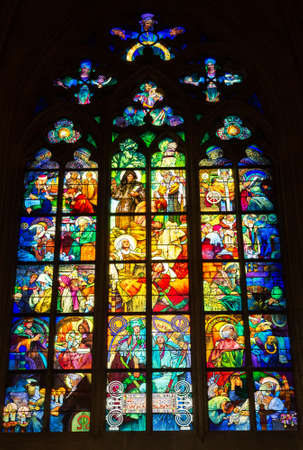 PRAGUE - MARCH 10, 2020: Stained glass Window designed by Art Nouveau painter Alfons Mucha in St. Vitus Cathedral, Prague, Czech Republic