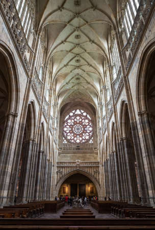 PRAGUE - MARCH 10, 2020: Interior of St. Vitus Cathedral in Prague. A group of tourists visiting the cathedral