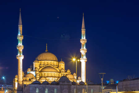 New Mosque (Yeni cami or Valide Sultan Mosque) with night illumination, Istanbul, Turkey