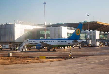 SAINT PETERSBURG, RUSSIA - MARCH 09, 2020: Passenger aircraft Boeing 757-200 of Uzbekistan airlines stands at Pulkovo International Airport near the terminal