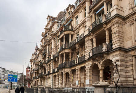 ZURICH, SWITZERLAND - FEBRUARY, 2010: Beautiful house with balconies, columns and sculptures at General-Guisan-Quai