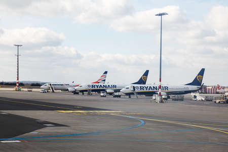 PRAGUE, CZECH REPUBLIC - MARCH 14, 2020: Passenger planes of low-cost airlines Ryanair and Smartwings stand at Prague International Airport