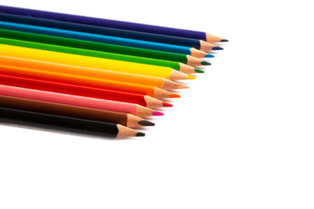 Colored pencils lie in a row, isolated on white background 免版税图像