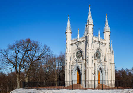 PETERHOF, SAINT PETERSBURG, RUSSIA - MARCH, 2021: Church of St. Alexander Nevsky in Gothic style (Gothic chapel) in Alexandria park