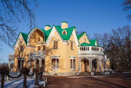 PETERHOF, SAINT PETERSBURG, RUSSIA - MARCH, 2021: Palace-cottage in Alexandria park in early spring