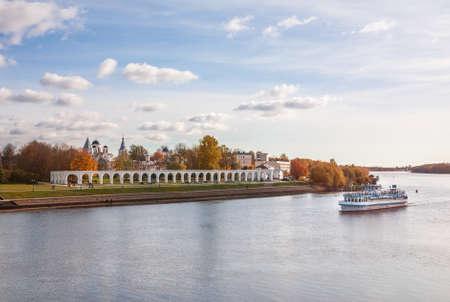 Cruise ship on the Volkhov River goes along the Yaroslav's Court. Novgorod Veliky, Russia