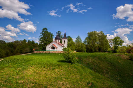 Picturesque summer landscape. Church of the Holy Trinity in the village of Bekhovo near the Polenovo estate. Tula region, Russia.