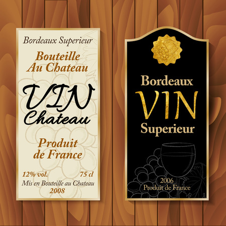 Vintage wine labels with hand-drawn details on wooden background