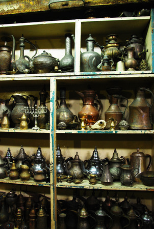 mezuzah: Vintage pitchers and lamps at a flea market Stock Photo