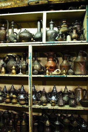 mezuzah: Vintage pitchers and lamps at a flea market Stock Photo
