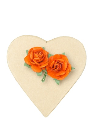 cardboard box in the form of hearts and flowers isolated on a white background photo